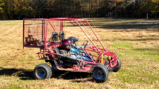 "Mr. Fix-It strapped the duck transport cage to the kiddos go-cart so the Ladybug and the Cowboy could drive out to the field to pick them up and bring them to the ""processing"" area in front of the garage."