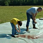 Putting the Summer Cover on the Chicken Hoop House